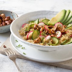 Quinoa salad with avocado and roasted nuts