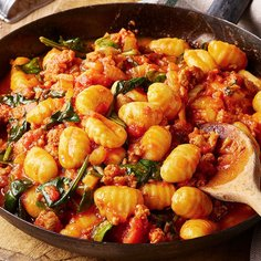 Spicy tomato and sausage gnocchi with fennel and spinach