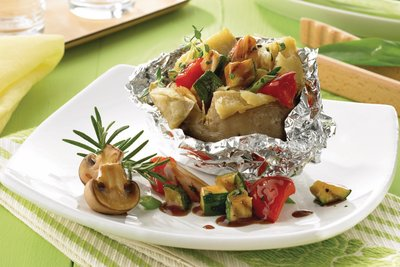 Barbecued vegetables with baked potatoes and herbs